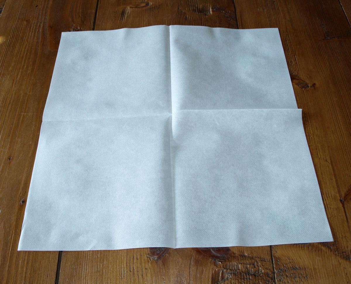 Pliage de serviette de table, réaliser un sac à main avec une
